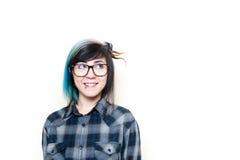 Mujer adolescente sonriente que mira para arriba su izquierda Fotografía de archivo libre de regalías