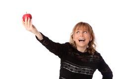 Mujer adorable que sostiene una manzana Imagenes de archivo