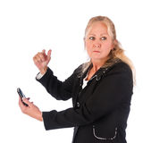 Mujer adulta enojada con el teléfono celular Fotos de archivo libres de regalías