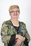 Mujer adulta media sonriente Imagen de archivo