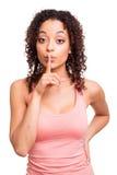 Mujer africana con el finger delante de su boca Foto de archivo libre de regalías