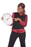 Mujer africana con el reloj Foto de archivo