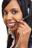 Mujer africana feliz con el receptor de cabeza Fotografía de archivo libre de regalías