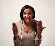 Mujer afroamericana enojada fotos de archivo
