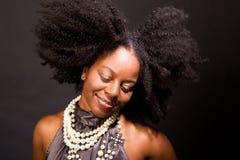 Mujer afroamericana que ríe y que baila Fotografía de archivo libre de regalías