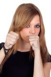 Mujer agresiva atractiva con la camisa negra Foto de archivo libre de regalías