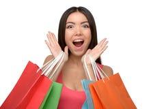 Mujer alegre asiática después de hacer compras con los bolsos Fotos de archivo