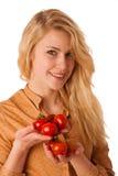 Mujer alegre caucásica rubia joven hermosa con los ojos azules ho Foto de archivo libre de regalías