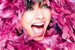 Mujer alegre en plumaje Imagen de archivo libre de regalías