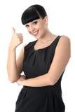 Mujer alegre feliz positiva con los pulgares para arriba que sonríe Imagen de archivo libre de regalías