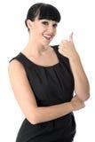 Mujer alegre feliz positiva con los pulgares para arriba que sonríe Fotos de archivo libres de regalías