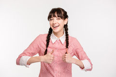 Mujer alegre que muestra los pulgares para arriba Imagenes de archivo