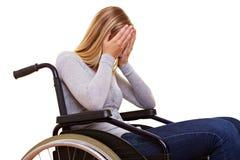 Mujer anónima en sillón de ruedas imagenes de archivo
