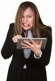 Mujer ansiosa con la tablilla Fotografía de archivo