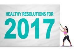 Mujer apta con la resolución sana y 2017 Foto de archivo