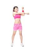 Mujer apta que estira su brazo para calentar Imagen de archivo