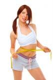Mujer apta sonriente con la cinta de la medida. imagen de archivo libre de regalías