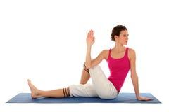 Mujer asentada en actitud de la yoga Foto de archivo