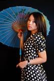 Mujer asiática con el paraguas Foto de archivo libre de regalías
