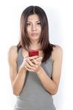 Mujer asiática con el teléfono celular Imágenes de archivo libres de regalías