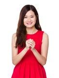Mujer asiática con la celebración de la mano Imagen de archivo