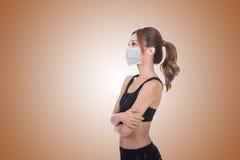 Mujer asiática con la máscara fotos de archivo libres de regalías