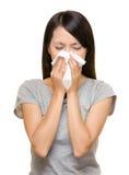 Mujer asiática de estornudo Fotografía de archivo libre de regalías