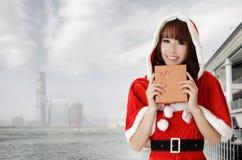 Mujer asiática de la Navidad Fotos de archivo