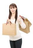 Mujer asiática de las compras Imagen de archivo libre de regalías