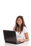 Mujer asiática en la computadora portátil Imágenes de archivo libres de regalías