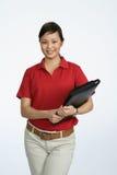 Mujer asiática en una camisa roja Imagen de archivo libre de regalías