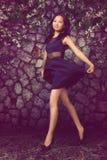 Mujer asiática en vestido negro Fotos de archivo libres de regalías