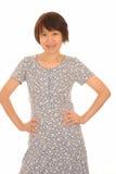 Mujer asiática feliz en alineada Imágenes de archivo libres de regalías