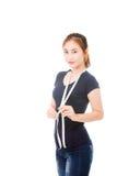 Mujer asiática hermosa que mide su cintura Fotografía de archivo libre de regalías