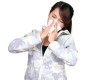 Mujer asiática joven de estornudo Imagen de archivo libre de regalías