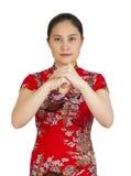 Mujer asiática joven hermosa con el gesto de la enhorabuena, happ Fotos de archivo