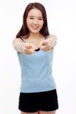 Mujer asiática joven que le señala Fotografía de archivo