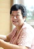 Mujer asiática mayor feliz 60s Imagen de archivo libre de regalías