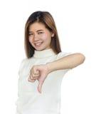Mujer asiática que da sus pulgares abajo Imagenes de archivo