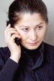 Mujer asiática que habla en el teléfono Fotografía de archivo libre de regalías