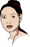 Mujer asiática que lleva un bollo sin un maquillaje Imagen de archivo