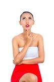 Mujer asiática que piensa estando pensativo Foto de archivo libre de regalías