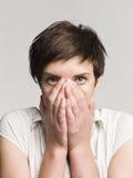 Mujer asustada Fotografía de archivo