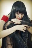 Mujer asustada con la arma de mano Imágenes de archivo libres de regalías