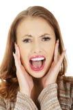 Mujer asustada que grita Foto de archivo libre de regalías