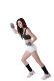 Mujer atlética joven pesos de una muñeca que llevan Fotos de archivo