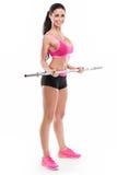 Mujer atractiva agradable que hace entrenamiento con la pesa de gimnasia grande, retocada Imagenes de archivo