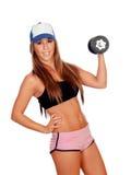 Mujer atractiva con el entrenamiento de las pesas de gimnasia Fotografía de archivo libre de regalías