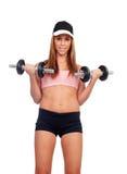 Mujer atractiva con el entrenamiento de las pesas de gimnasia Foto de archivo libre de regalías