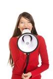 Mujer atractiva con el megáfono Imagenes de archivo
